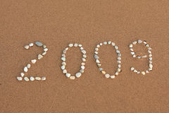 2009 year. Figures from little stones on the sand Stock Photos