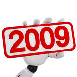 2009 year sign. The robotic hand hold a plate with 2009 number Stock Image