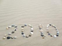 2010 auf Strand Stockfoto