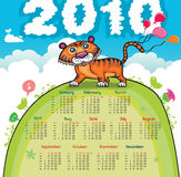 2010 Calendar with cute tiger. On green hill Royalty Free Stock Image