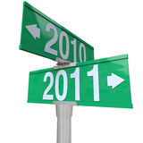 2010 Changing to 2011 - Two-Way Street Sign. A green two-way street sign pointing to the years 2010 and 2011 Royalty Free Stock Photo