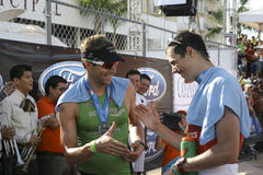 2010 Cozumel's Iron Man. 28 November 2010. Cozumel's Iron 2nd place winner Michael Lovato and 1st place winner Andy Potts, shaking hands after finishing the race Royalty Free Stock Image