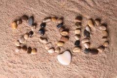 2010 en sable Photographie stock libre de droits