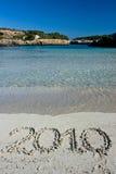2010 escrito na areia Imagens de Stock Royalty Free