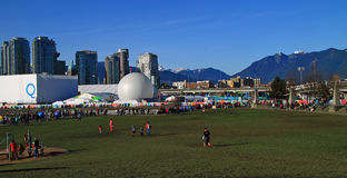 2010 Olympics in Vancouver. Vancouver 2010 Olympic games events with background of Vancouver skyline, Saskatchewan Pavilion and Quebec House Royalty Free Stock Photo