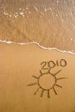 2010 op het zand Stock Foto's