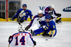 2010 Paralympic Winter Games. Sledge hockey, Sweden versus Korea, in the 2010 Vancouver Paralympic Winter Games royalty free stock photos