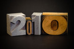 2010 in print letters. Wooden typescript letters forming number 2010 Stock Images