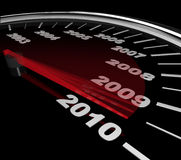 2010 - Speedometer Reaching New Year. The red needle on a speedometer speeds toward the year 2010 Stock Images