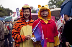 """2010 Taiwan LGBT Pride Parade. Took place in Taipei, on October 30, 2010. This year's theme is """"Out & Vote."""" We are angry because the politicians in Stock Photo"""