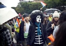 """2010 Taiwan LGBT Pride Parade. Took place in Taipei, on October 30, 2010. This year's theme is """"Out & Vote."""" We are angry because the politicians in Stock Photos"""