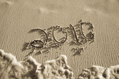 2010 written in sand on beach Royalty Free Stock Image