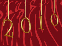 2010 year of the Tiger. 2010 numbers hanging on tiger skin Stock Images