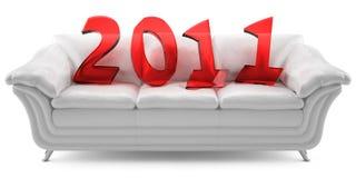 2011 Años Nuevos en un sofá de cuero blanco Fotos de archivo