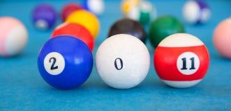 2011 bildeten von den Billiardkugeln Stockfotografie