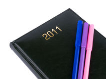 2011 black organizer with pens Royalty Free Stock Image