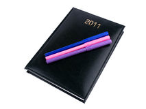 2011 black organizer with pens Royalty Free Stock Photography