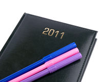 2011 black organizer with pens Royalty Free Stock Images