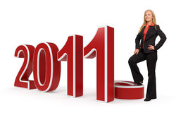 2011 - Business woman. 3d rendered illustration of 2011 symbol combined with a photo of a young happy business woman Stock Photography