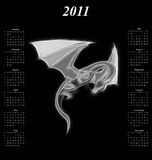 2011 calendar. With abstract image of a stylised mythical Dragon Stock Images