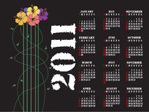 2011 calendar. Editable 2011 calendar with hibiscus flowers on black background stock illustration