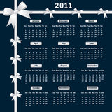 2011 Calendar with bows. Calendar 2011 year with white bows on a dark background Stock Photography