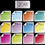 2011 calendar on colored sheets. Over black background Stock Images