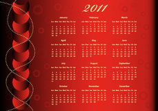 2011 Calendar full year. On a red background decorated with balls and beads Stock Photography