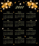2011 Calendar full year. Decorated with golden stars and circles on a black background Royalty Free Stock Images