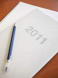 2011 Diary Book. With pen and notebook on desk Stock Photo