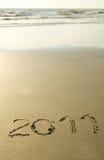 2011 escrito na areia Imagens de Stock Royalty Free