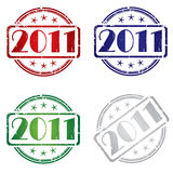 2011 Grunge stamp. Grunge rubber stamp with 2011 in colors Royalty Free Stock Image
