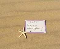 2011 Jahr auf Sand Lizenzfreie Stockfotografie