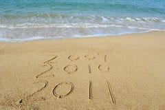 2011 Jahr auf Sand Lizenzfreie Stockbilder