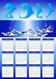 2011 kalenderdelfiner Arkivfoto