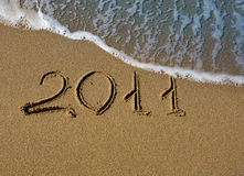 2011 - La inscripción en la arena en el mar Fotografía de archivo libre de regalías
