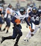 2011 le football de NCAA - brouillage de QB dans la neige Image libre de droits