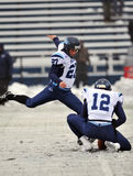 2011 NCAA Football - Kicking in the snow Royalty Free Stock Photography