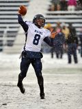 2011 NCAA Football - pass in the snow Stock Images