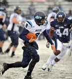 2011 NCAA Football - QB scramble in the snow Royalty Free Stock Image