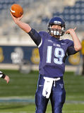 2011 NCAA football - quarterback throwing Royalty Free Stock Images