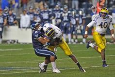 2011 NCAA football - tackled. CHESTER, PA - NOVEMBER 19: Villanova running back Lawrence Doss (#2) is hit hard in the open field during the Delaware-Villanova Stock Images