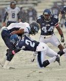 2011 NCAA-Fußball - Gerät im Schnee Stockfotografie