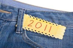 2011 nella casella dei pantaloni del Jean blu del denim Fotografia Stock