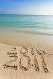 2011 neuf. L'onde enlève une inscription 2010. Images libres de droits