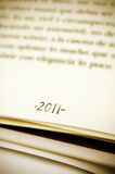 2011,new year. 2011 as a footnote on a book page Royalty Free Stock Images