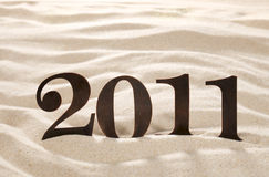 2011 new year metal numbers on beach sand Royalty Free Stock Photo