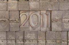 2011 - priorità bassa dei blocchetti di stampa del metallo Fotografia Stock Libera da Diritti