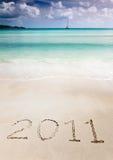 2011 schrijft in het zand van een tropisch strand Stock Afbeelding
