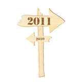 2011 sign. A signpost showing the way from 2010 to 2011. Rustic style. Also available in vector format stock illustration